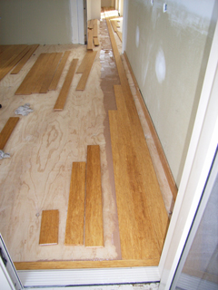 Getting the compressed bamboo floor straight.