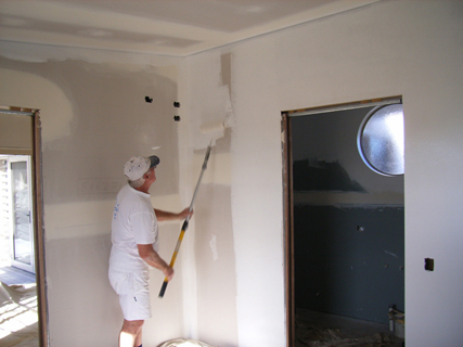 Gareth applying Dulux 1 Step Acrylic Sealer