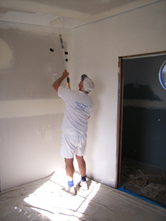 Gareth the painter applying Dulux 1 Step Acrylic Sealer